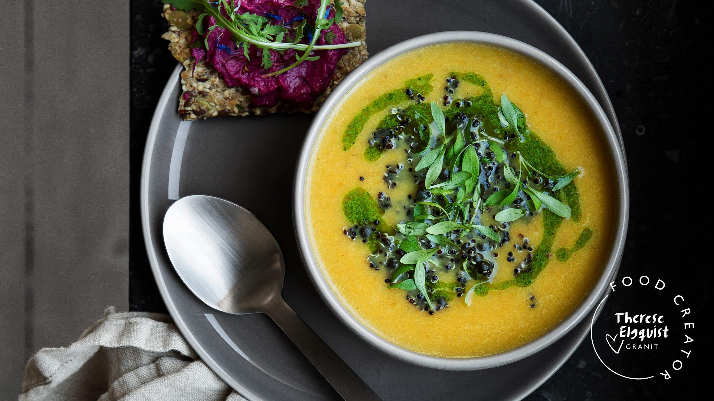 Rotsakssoppa med quinoa- och belugalinssallad, örtolja och korianderskott